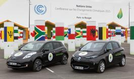 The_Nissan_LEAF_and_the_Renault_ZOE_in_front_of_the_blue_zone_at_the_Bourget_where__the_COP21_negotiations_took_place