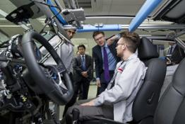 426170755 UK Business and Energy Secretary Greg Clark talks with Nissan electrical