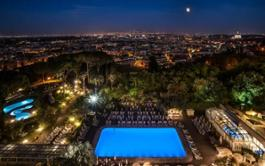 Night time view over Rome from hotel terrace