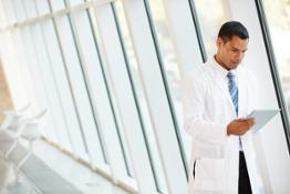 doctor-reading-fhi-report-on-tablet