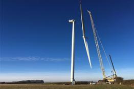 france-wind-turbine-works-crane-lifting-blades-blue-sky