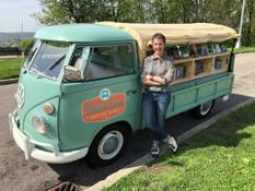 Melanie Moore poses in front of her teal 1962 Volkswagen Transporter which doubles as The Book Bus.--12477