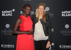 """Caroline Rupert (right) poses with filmmaker Zippy Kimundu at the """"Power of Words"""" film premiere in Cape Town, South Africa on 13 November 2014."""